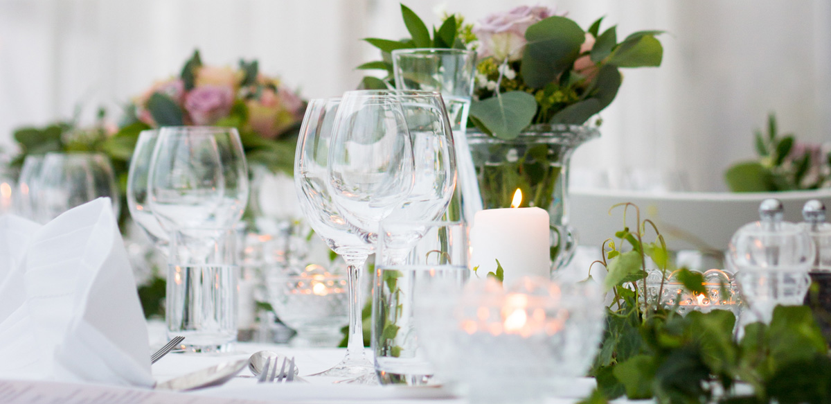 Formal Table Setting with Silverware, Stemware, Glass Tealight Candle Holders, Glass Flower Vases - Event Decor